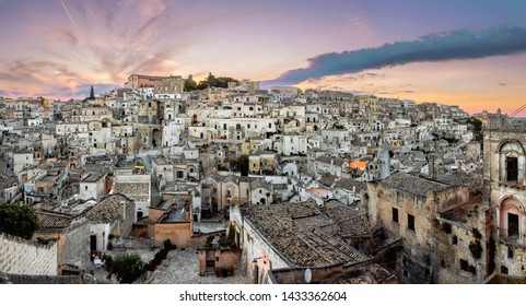 Matera, Basilicata/Italy - august 31 2013: Panoramic view of the famous ancient stone city of Matera at sunset.