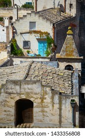 Matera, Basilicata/Italy - september 01 2013: Beautiful Glimpse of a terrace and roof top pf the stone city of Matera,in the southern Italy, Unesco heritage city and  european capital of culture 2019.