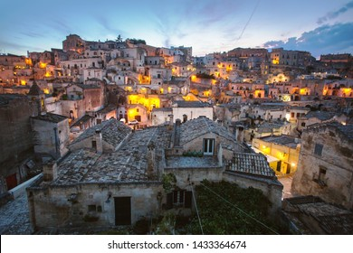 Matera, Basilicata/Italy-august 31 2013: Beautiful view of the famous ancient stone city of Matera at dusk, unesco heritage and european capital of culture 2019.