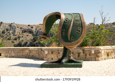 Matera, Italy - August 10, 2020: the clock melting, the work of Salvador Dali Spanish surrealist artist in an exhibition dedicated to him in Matera.