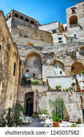 """Matera, Italy - AUGUST 2017 - The historic center of the wonderful stone city of southern Italy, Basilicata region, a tourist attraction for the famous """"Sassi"""" old town."""