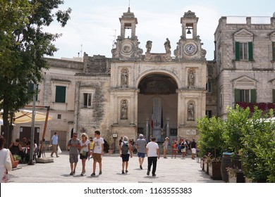 "Matera, Italy - August 22, 2018: Tourists enjoying Piazza del Sedile in Matera city centre. The Italian city of Matera is worldwide known for its ""Sassi"""