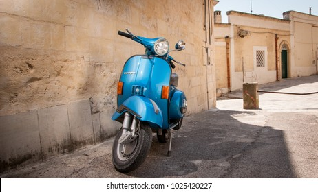 Matera, Italy - August 29, 2011: Scooter Vespa parked on old street