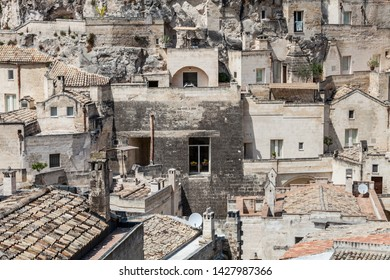 Matera, Italy. July 25, 2015: Old stones house buildings and ancient Italian village in Matera in Italy. Full picture of white buildings made with stones. Cluster of houses. Matera, Italy