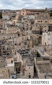 """Matera, Italy - July 29, 2019: View of Matera.  Matera is a city in the region of Basilicata, in Southern Italy. Its historical centre """"Sassi"""" contains ancient cave dwellings."""