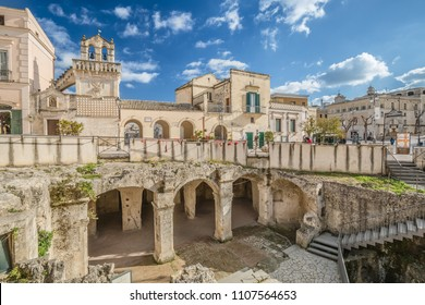 MATERA, ITALY - MARCH 2018: walking the streets of the old town of Matera, view of Matera city centre square, facing Materdomini church.