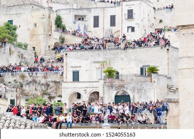 Matera, Italy - October 5, 2019: Many young people sitting on the city walls participate in the final Art of the Red Bull Movement sponsored by Huawei.