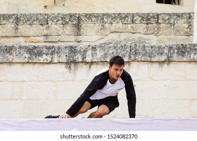 """Matera, Italy - October 5, 2019: Charls Luong in action during the final of Red Bull's """"Art of Motion""""."""