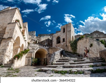 MATERA, ITALY  SEPTEMBER 15, 2014: Turists visit ancient town of Matera Sassi di Matera. The city is a UNESCO World Heritage site and European Capital of Culture for 2019
