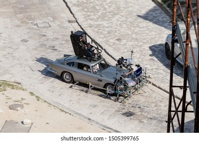 """Matera, Italy - September 15, 2019: Bond25, the Aston Martin Db5 super equipped with all the shooting equipment shoots some scenes of the 007 film """"No Time To Die"""" among the Sassi of Matera-Italy."""