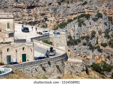 """Matera, Italy - September 15, 2019: Bond 25, Aston Martin DB5 while filming chase scenes through the narrow streets of the movie """"No Time to Die"""" in Sassi, Matera, Italy."""