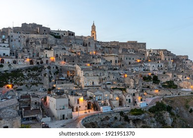 Matera; Italy - September 15; 2019: Evening view of the city of Matera; Italy; with the colorful lights highlighting old buildings in the Sassi di Matera a historic district in the city of Matera.
