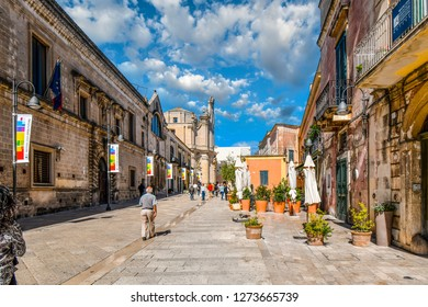 Matera, Italy - September 25 2018: Tourists and locals walk the Via Domenico Ridola towards the Purgatory Church in the center of the newer section of Matera Italy, in the Basilicata Region