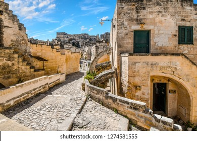 Matera, Italy - September 25 2018: A typical stone back street in the ancient sassi of Matera Italy.