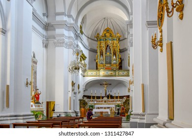 Matera, Italy - September 25 2018: Interior nave, pews and altar of the baroque Convent of Saint Agostino in the ancient city of Matera, Italy, in the Basilicata region
