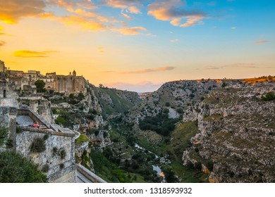 Matera, Italy - September 25 2018: Tourists enjoy a sunset meal on a terrace in the ancient city of Matera, Italy, overlooking the sassi caves, canyon ravine and the Convent of Saint Agostino