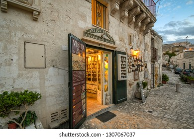 Matera, Italy - September 26 2018: A small artist shop in the medieval city center of the prehistoric city of Matera, Italy, at dusk.