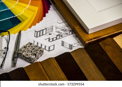 Material selection for kitchen remodeling project on designer desk with design and cabinet doors