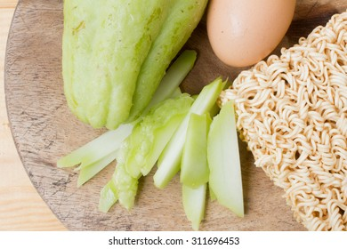 material Spicy noodles egg and vegetable wood background