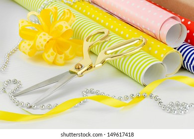 Materials and accessories for wrapping gifts isolated on white