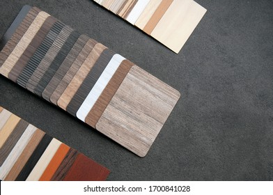 Materials design. wood laminate for Interior design. home design and renovation with sample of wood texture. wood texture of veneer, laminate, vinyl, wallpaper on table background.