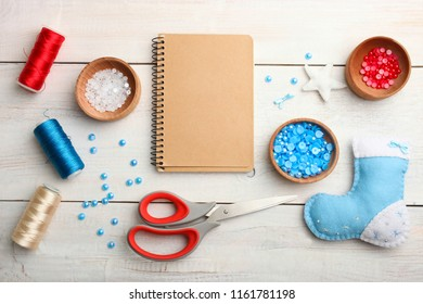 Materials and equipment for sewing on wooden background. Concept handmade. Top view.