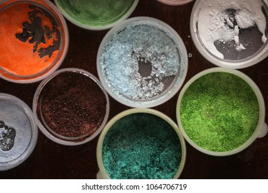 Materials and tools for creativity, enamel in the caps, pistils. Background and different colors, making ornaments with enamel
