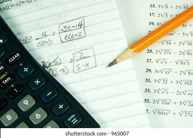 A math book with a calculator and math paper