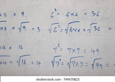 Math equation on the whiteboard. Numerical calculation using logarithm rooting method. Education concept. Close up and blur. For background and design.