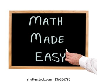 Math made easy is written in chalk on a chalkboard.