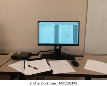A math phd student's working desk with a dell computer and some papers lying around.  Bloomington, IN, August 14, 2019