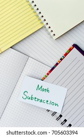 Math Subtraction; Many Notebooks on the Working Table