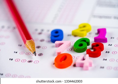 Math symbol and pencil on Answer sheet background : Education study mathematics learning teach concept.