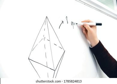 Math teacher drawing octahedron, preparation for SAT, preparation for math test, geometry teacher