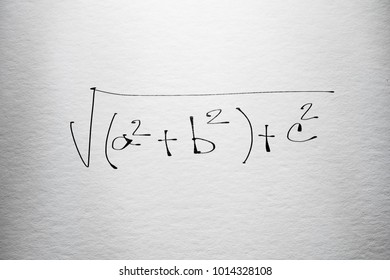 Mathematic formula examples free hand written on textured clean paper