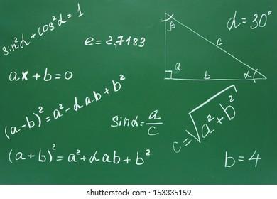 Mathematical formulas on a school board.