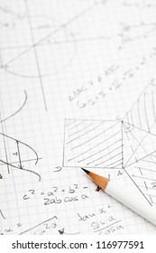 Mathematical notes about geometry and trigonometry with pencil on note paper
