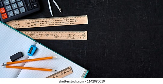 Mathematics education equipment tools.  Formula equation symbol printed on rulers. Study concept. Solve mathematical problem.