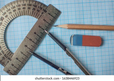 Mathematics geometry tool for student in math class with copy space for text on paper graph background. Mathematics concept