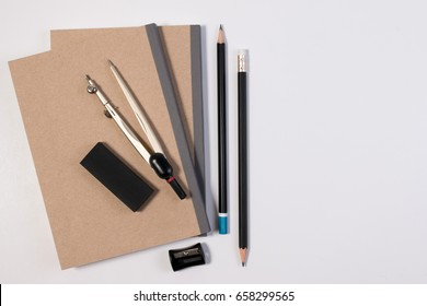 Mathematics math desk or math office supplies. Education math workplace with pen, notebook, divider compass in Mathematics class with white background and copy space for text.