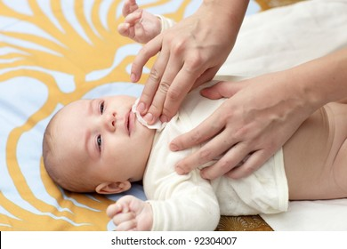 A mather cleaning baby in morning at home