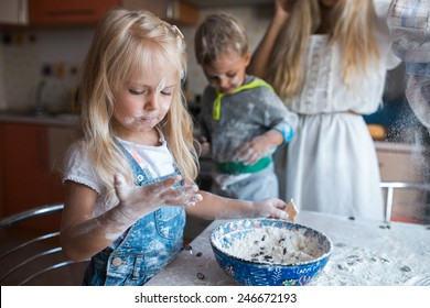 Mather have fun with kids on kitchen