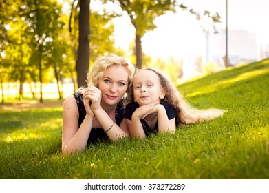 Mather and her daughter on the park
