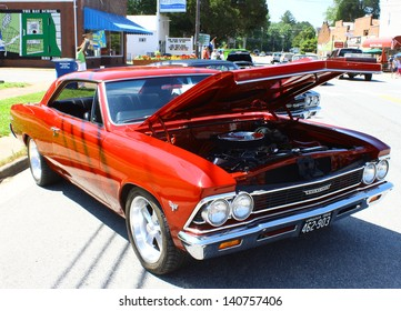 """MATHEWS, VA- JUNE 01:1966 Chevy Chevelle right side in the Annual: Vintage TV's """"Chasing Pavement Vintage Automotive Festival"""" in Mathews, Virginia on June 01, 2013"""
