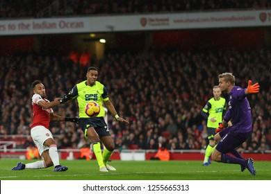 Mathias Jorgensen of Huddersfield Town holds off Pierre-Emerick Aubameyang of Arsenal - Arsenal v Huddersfield Town, Premier League, Emirates Stadium, London (Holloway) - 8th December 2018