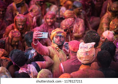 MATHURA, INDIA - Feburary 25,2018: Man takes selfie and have fun in colors during traditional holi festival