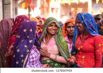 MATHURA, INDIA - Feburary 25,2018: Women in colorful sarees in the village of Agra, India