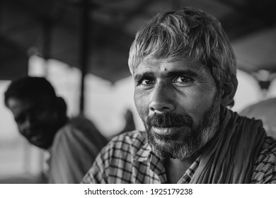 MATHURA, INDIA - OCTOBER 12, 2019: Portrait of manual workers employed to move bags of cement at railway junction on October 13, 2019 in Mathura, Uttar Pradesh, India.