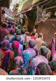 Mathura Vrindavan, Uttar Pradesh, India; 21-Feb-2019; crowd playing Holi on the streets of Vrindavan