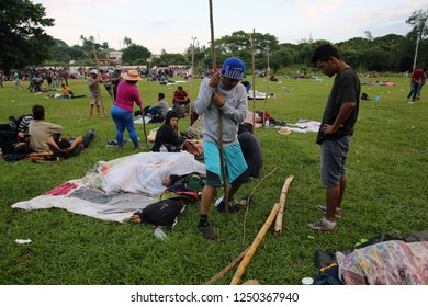 Matias Romero, Oaxaca / Mexico - Nov. 10, 2018: Salvadorans fleeing poverty and gang violence in the third caravan to the U.S. build shelters from found materials at dawn at an ad hoc migrant shelter.